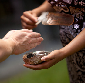 hands in a ceremony